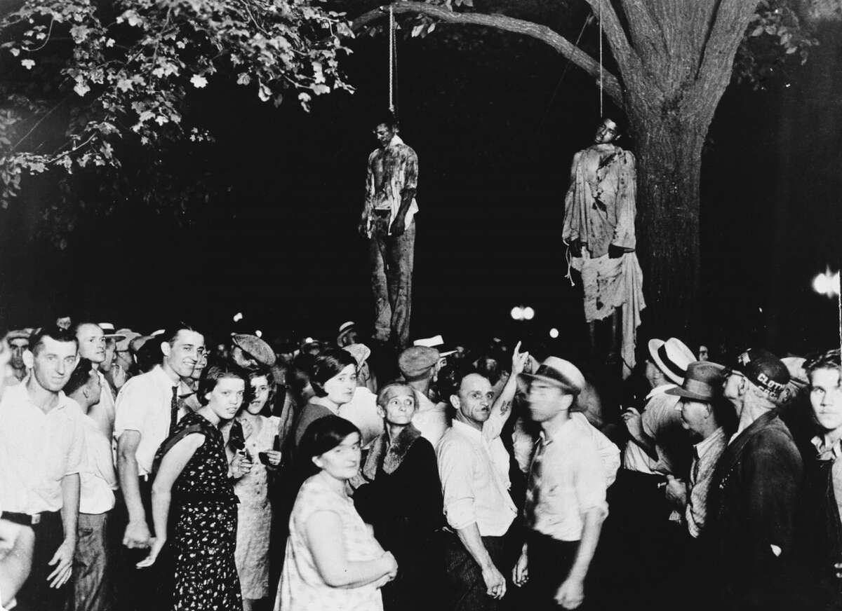 """A crowd gathers to witness the lynching of Thomas Shipp and Abram Smith on Aug. 7, 1930, in Marion, Indiana. This image was the inspiration for the poem """"Strange Fruit"""" by Abel Meeropol."""