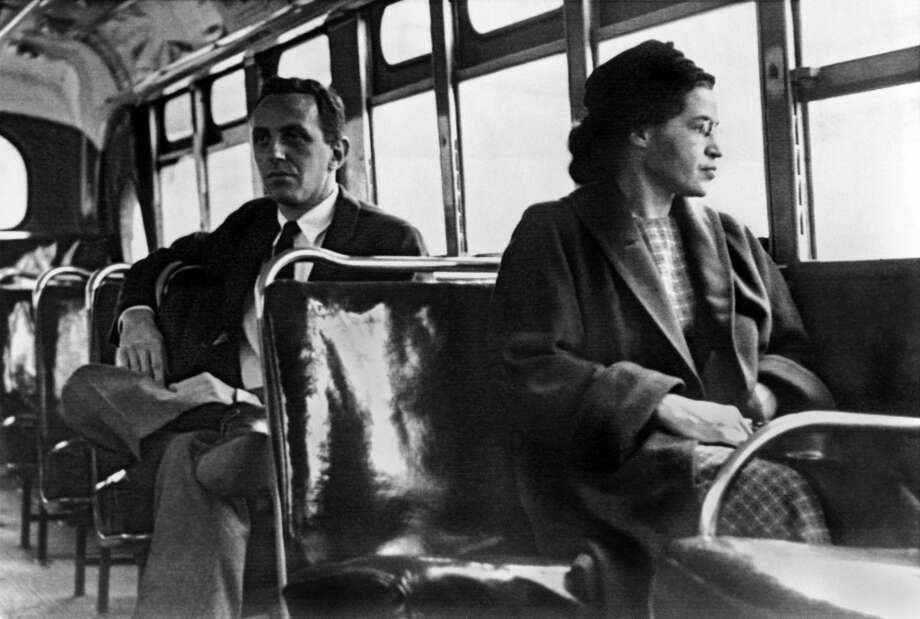 On Dec. 1, 1955, Rosa Parks, a black seamstress, was arrested after refusing to give up her seat to a white man on a Montgomery, Alabama, city bus; the incident sparked a year-long boycott of the buses by blacks. Photo: Underwood Archives, Getty Images