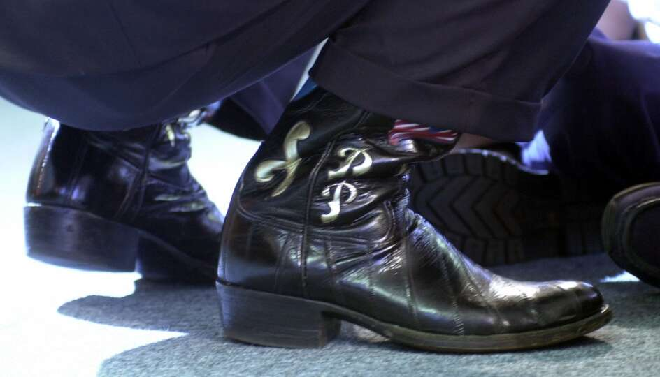 Texas Gov. Rick Perry wears his boots during a campaign event Sept. 26, 2002 in Houston.