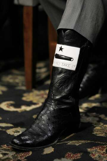 Republican presidential candidate, Texas Gov. Rick Perry displays his boot during a CafeMom town hal