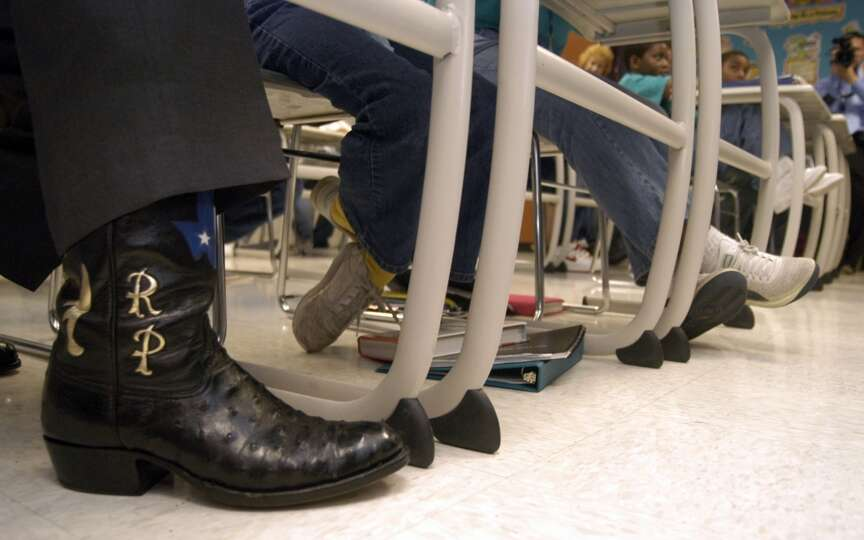 Boots of Texas Gov. Rick Perry stood side-by-side sixth graders during a class at Pin Oak Middle Sch