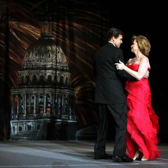 Governor Rick Perry, wearing boots, dances with his wife Anita at the Inaugural Ball for Governor Pe