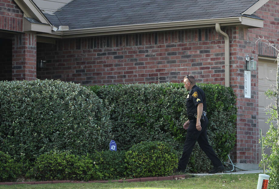 San Antonio police process the scene of a shooting that took place Thursday July 3, 2014 at a home on the 12,100 bockof Arbor Mesa. Sergeant Javier Salazar said the victim was a 57-year-old male and described the incident as a family disturbance. Photo: JOHN DAVENPORT, San Antonio Express-News / ©San Antonio Express-News/John Davenport
