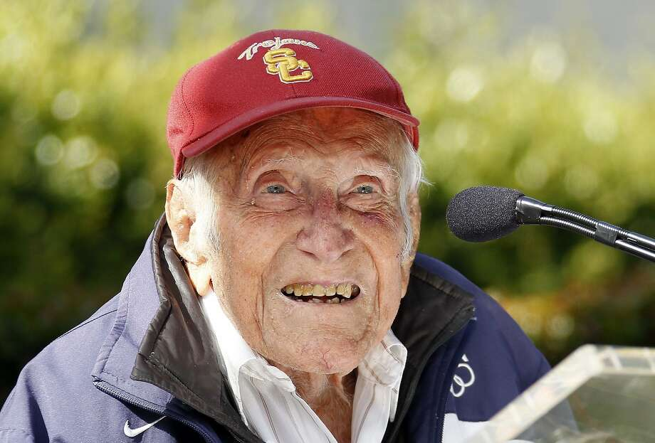 Louis Zamperini gestures during a news conference Friday May 9, 2014 in Pasadena, Calif. Ninety-seven-year-old World War II hero and former Olympian, Zamperini has been named grand marshal of the 2015 Rose Parade.(AP Photo/Nick Ut) Photo: Nick Ut, Associated Press