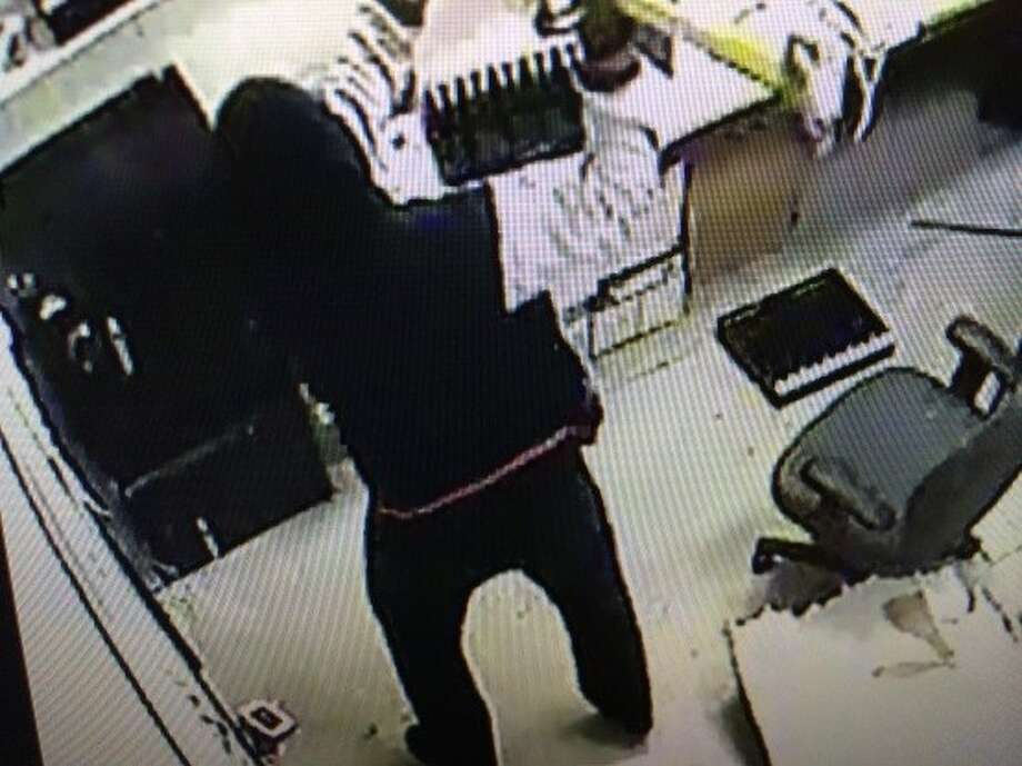 SAFE ROBBERY: Two men used a sledgehammer to break into a safe at a store along U.S. 59 in Harris County. RELATED: Robbers batter store safe with sledgehammer in NW Harris Co. Photo: Crime Stoppers
