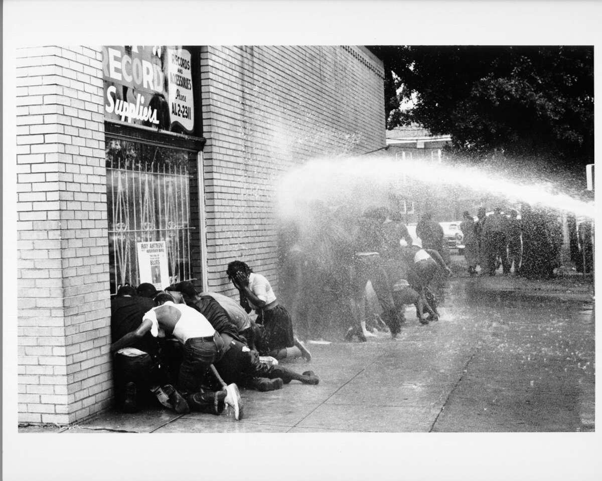 African American children are attacked by dogs and water cannons during a protest against segregation organized by Reverend Dr. Martin Luther King Jr. and Reverend Fred Shuttlesworth in May 1963 in Birmingham, Alabama.