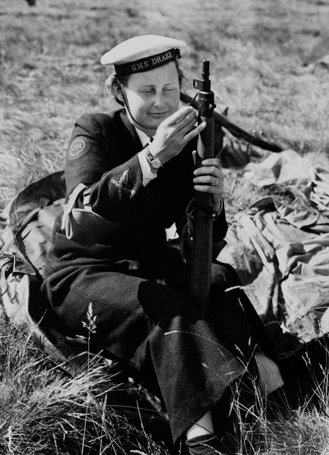 1955 -- A young woman inspects her rifle at a National Rifle Association meeting. No word on whether she was in the Russian navy, as her hat would suggest. Photo: KEYSTONE FRANCE, Getty Images / KEYSTONE FRANCE