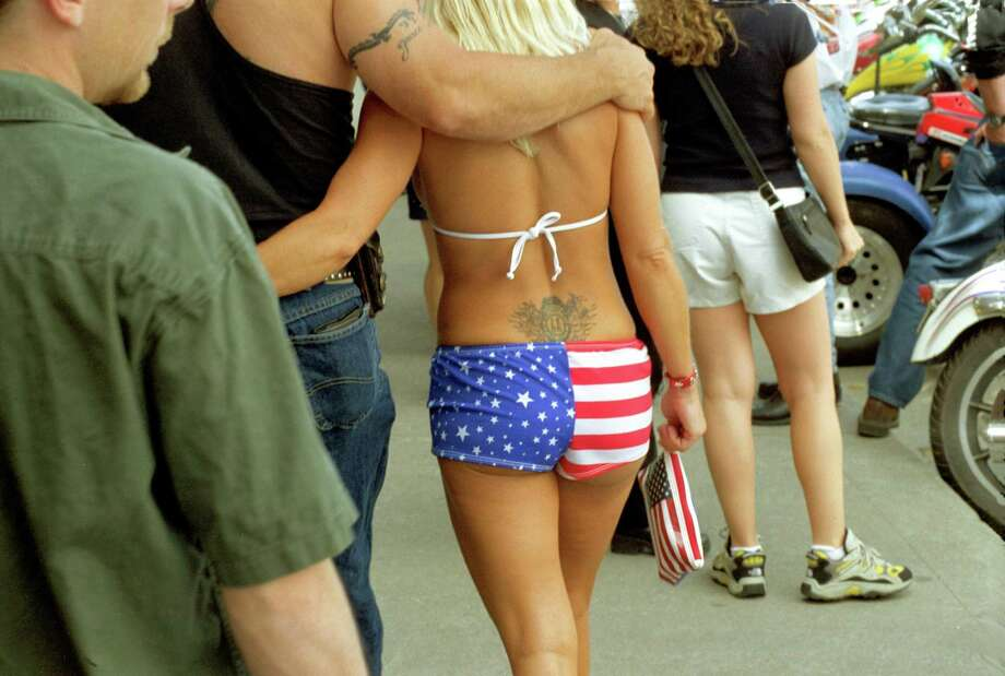 "2002 -- That tramp stamp reads ""Live Free or Die."" We hope. Photo: Chuck Nacke, Getty Images / Chuck Nacke"