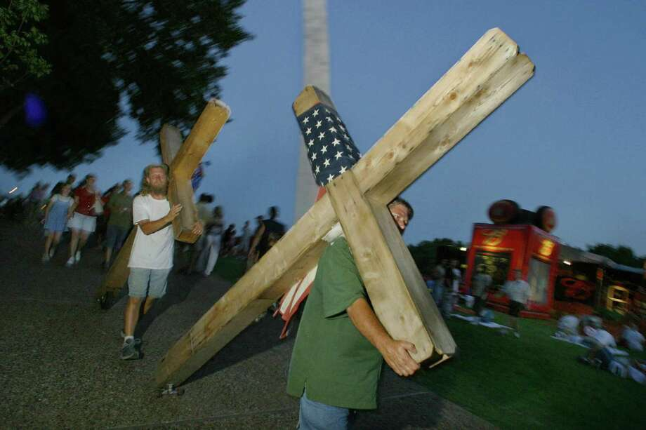 2003 -- His cross to bear is a bit heavier, and a lot more literal. Photo: ROBYN BECK, Getty Images / 2003 AFP