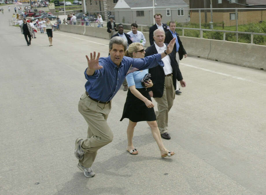 2004 -- Wild man John Kerry cuts loose at a parade. Photo: HECTOR MATA, Getty Images / 2010 AFP