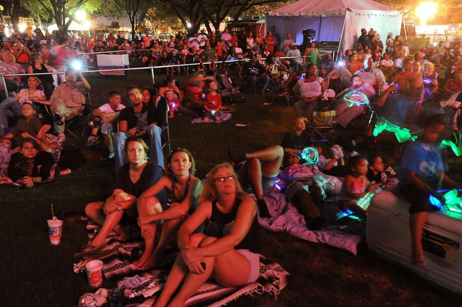 A crowd watches the annual fireworks show from Riverfront Park in 2010. Jefferson County commissioners were expected to rule Monday  on whether there will be a full or partial ban on Fourth of July fireworks in the county. Enterprise file photo Photo: Guiseppe Barranco/The Enterprise