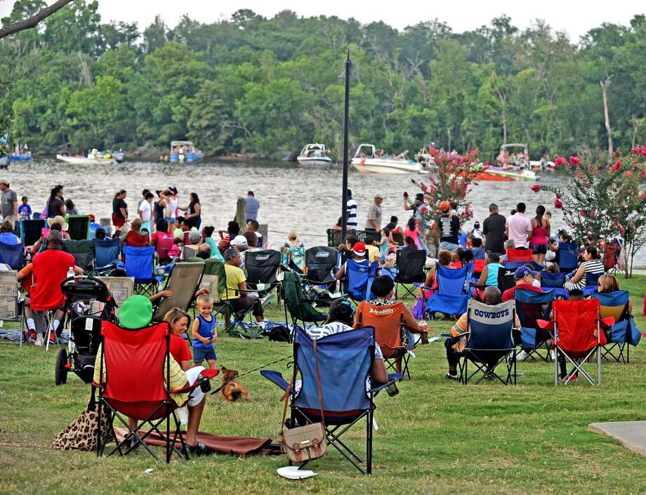 Beaumont residents slowly fill the park and the Neches River during the City of Beaumont Fourth of July Celebration on Thursday, July 4, 2013 at Riverfront Park. Photo taken: Randy Edwards/The Enterprise