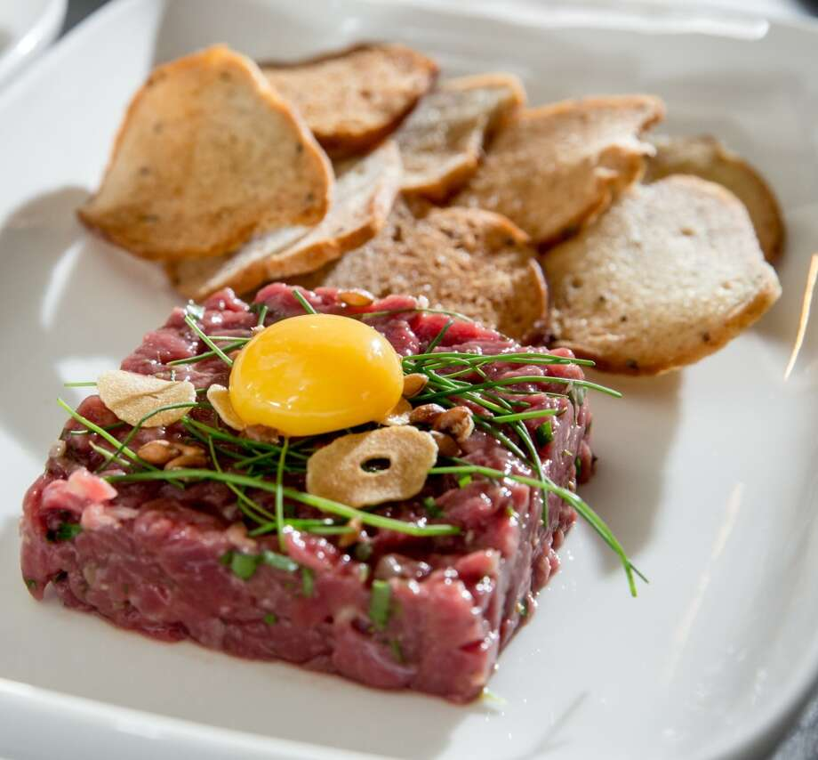 Steak tartare, garlic, caper, shallot, quail egg ($13) Photo: Hardy Wilson
