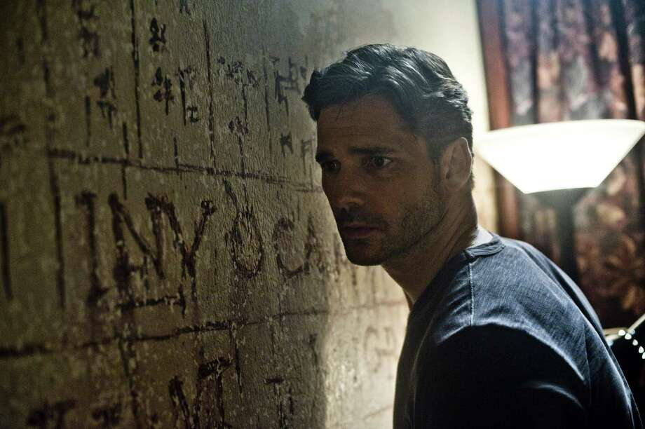 Andrew Schwartz/Screen Gems A baffled Sarchie (ERIC BANA) studies the bizarre words and symbols and hears sounds from beyond the wall in Screen Gems' DELIVER US FROM EVIL. Photo: Andrew Schwartz / © 2014 Screen Gems, Inc.  All Rights Reserved. ALL IMAGES ARE PROPERTY OF SONY PICTURES ENTERTAINMENT INC. FOR PROMOTIONAL USE ONLY.  SALE, DUPLICATION OR TRANSFER OF THIS MATERIAL IS STRICTLY PROHIBITED.