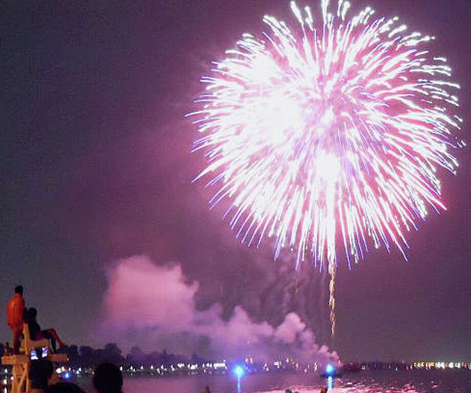 "Limited parking, increase fees and ""parking zones"" will be in effect for the town's fireworks display. Photo: File Photo / Fairfield Citizen"
