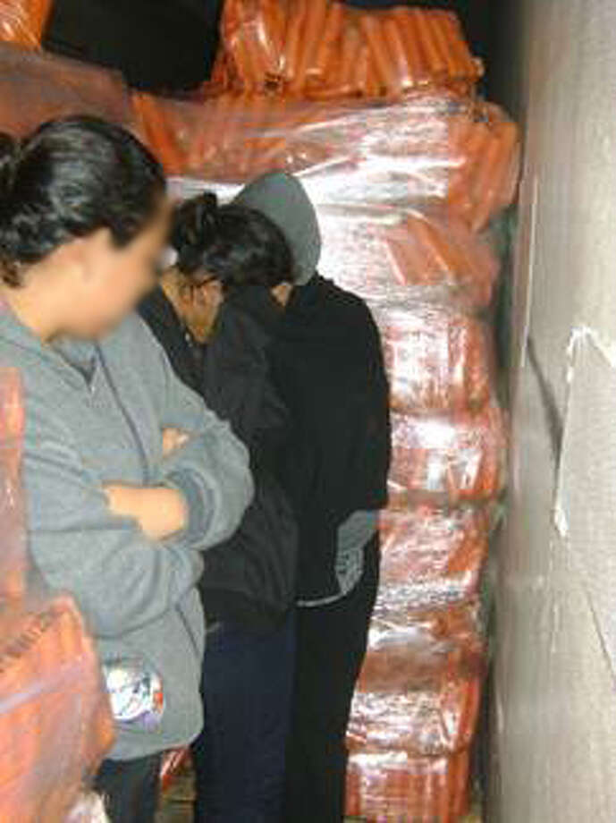 Authorities rescued 15 people Thursday from a locked tractor-trailer in Falfurrias on Thursday, July 3, 2014. They are  believed to be in the country illegally. Photo: U.S. Customs And Border Protection