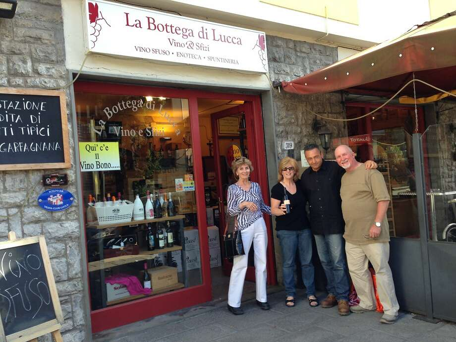 Audrey, Tim and Delores with the proprietor of their favorite shop in Lucca. Photo: Courtesy Audrey West