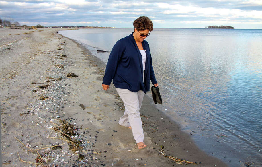 "Iraq war veteran Eunice Ramirez finds comfort in her walks at Walnut Beach in her hometown of  Milford, Conn. Ramirez, Stamford native, does mindfulness exercises every day ""to keep the depression at bay."" Photo: Tony Bacewicz / Connecticut Post Contributed"