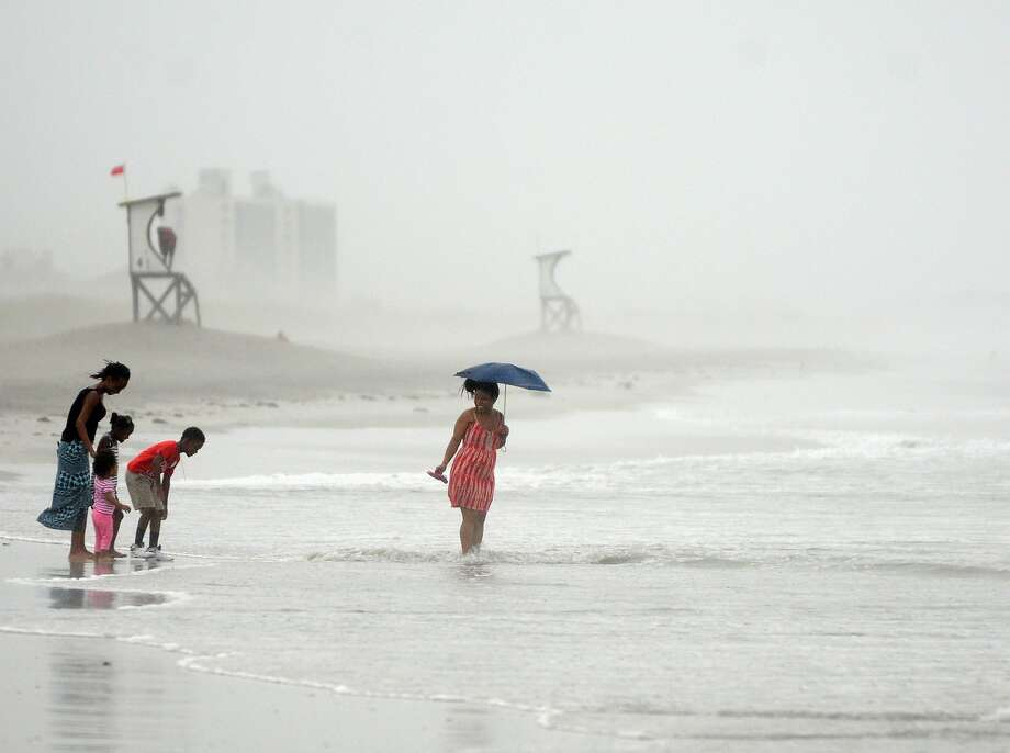 Beachgoers at Wrightsville Beach, N.C., play ahead of Hurricane Arthur, which made landfall on the state's Outer Banks on Thursday night. Photo: Mike Spencer, Associated Press
