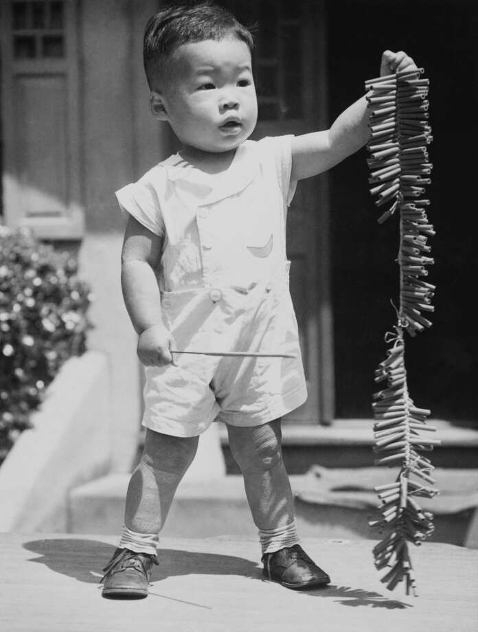 1910: Baby Garey Low preparing to celebrate the Fourth of July in San Francisco. Photo: Keystone-France, Gamma-Keystone Via Getty Images