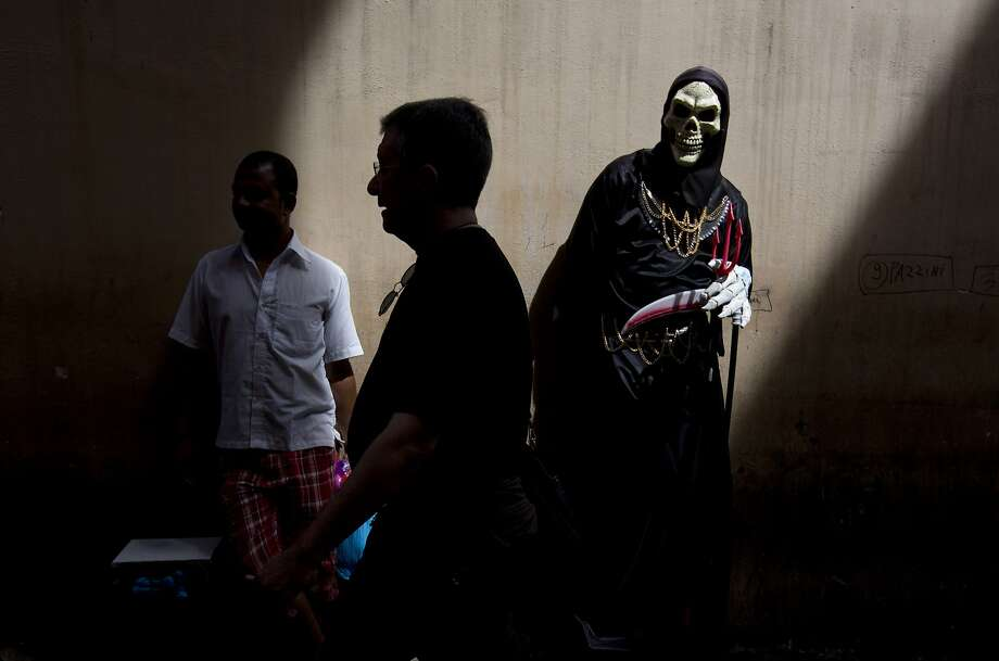 Death lurks in the streets of Rome. Photo: Alessandra Tarantino, Associated Press