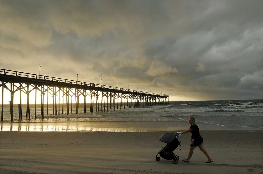 Clouds and rains move in on the north end of Carolina Beach, N.C. Residents along the coast were 