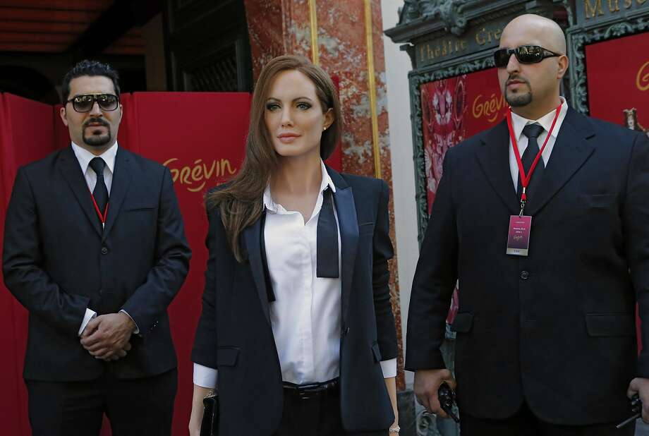 But where is wax Brad? Angelina Jolie is wax, her security guards - while just as wooden-looking - are real. (Grevin 