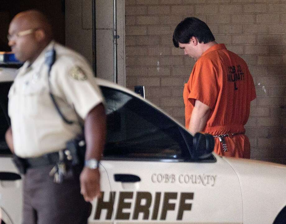 Justin Ross Harris (right) heads for the bond hearing in the death of his toddler son in Marietta, Ga. Photo: David Goldman, Associated Press