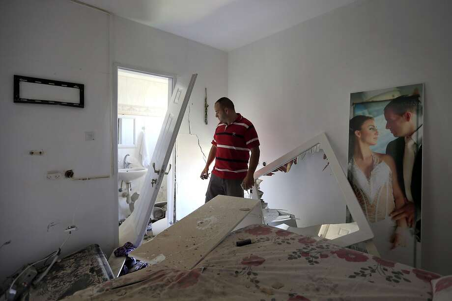 Avihai Giorno stands in his bedroom after a rocket fired by Palestinian militants in Gaza landed in the southern Israeli town of Sderot. Photo: Tsafrir Abayov, Associated Press