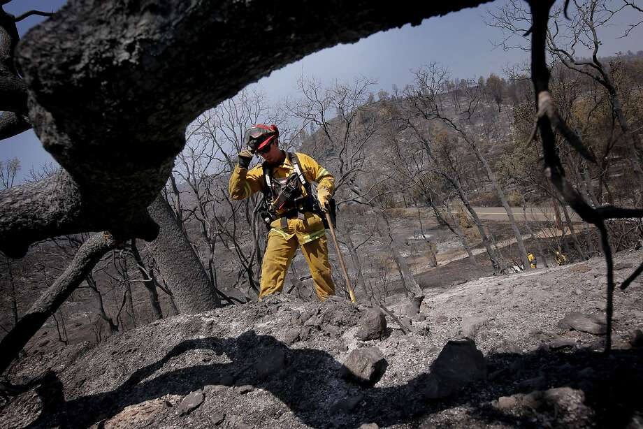 Capt. Patrick Mills with the Forestville Fire Department searches for hot spots along Snell Valley Road in Pope Valley. Photo: Michael Macor, The Chronicle