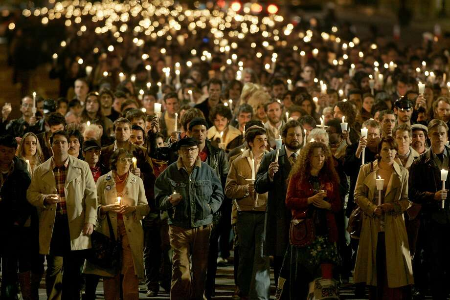 """Speechwriter and science fiction novelist Frank M. Robinson (center), who played himself in the Gus Van Sant biography """"Milk,"""" takes part in the candlelit vigil march being filmed on Market Street in 2008. Photo: Kat Wade, Special To The Chronicle"""