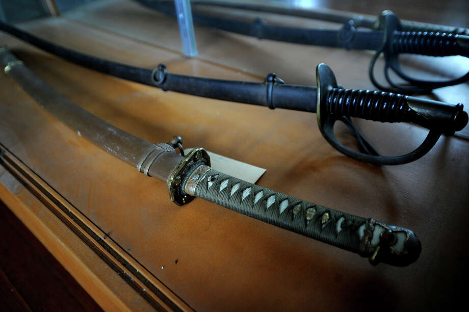 Among other military items, a World War 2 Japanese general's sword, and earlier U.S. Cavalry sword, formerly stored at the Fowler building in Milford, are now on display at the West Haven Veterans Museum and Learning Center at 30 Hood Terrace in West Haven. Photo: Brian A. Pounds / Connecticut Post