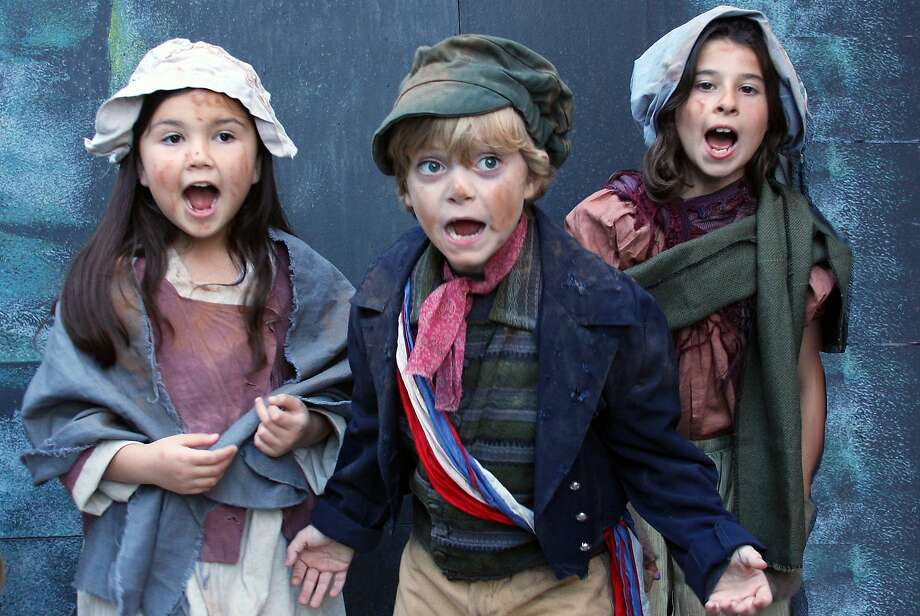 "Zell Steel Morrow (center) as street urchin Gavroche (with urchins Enrica Waugh, left, and Madison Jane Schlader) in Woodminster Summer Musicals' ""Les Miserables"" NOTE: Miserables takes accent / over the first e. Photo: Kathy Kahn"