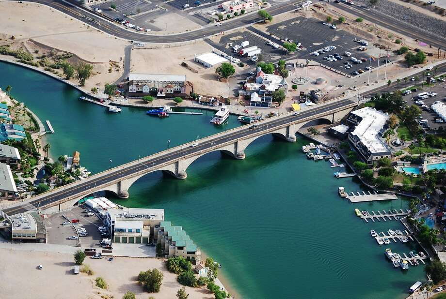 FILE - In this June 3, 2009 file photo, provided Courtesy of the Lake Havasu City Convention and Visitors Bureau, shows London Bridge, which spans the Colorado River at Lake Havasu City, Ariz. The London Bridge is not falling down, despite a British tabloid saying that the Lake Havasu City tourist attraction is being bulldozed to make way for drug tourism. Lake Havasu City officials heard about the story in The Sun after a local resident visiting the United Kingdom brought back a copy of the tabloid. They say it was a slap in the face and demanded a retraction and an apology. (AP Photo/Courtesy of the Lake Havasu City Convention and Visitors Bureau) Photo: Associated Press