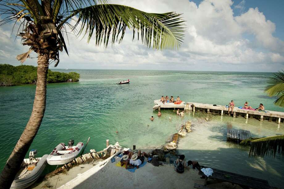 Vacationers relax at Caye Caulker, Belize. The beach town is a laid-back, low-cost base for tourists looking to explore a nearby barrier reef. Photo: Belize Tourist Board / Belize Tourist Board