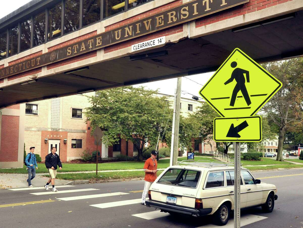 Cars must stop for pedestrians in marked crosswalk areas without stop lights.