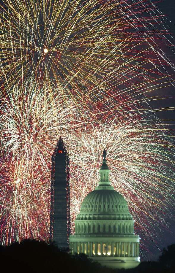 Fourth of July fireworks are seen over the U.S. Capitol and Washington Monument in 2013. We joyously celebrate our freedom again. Photo: Paul J. Richards / AFP / Getty Images / AFP