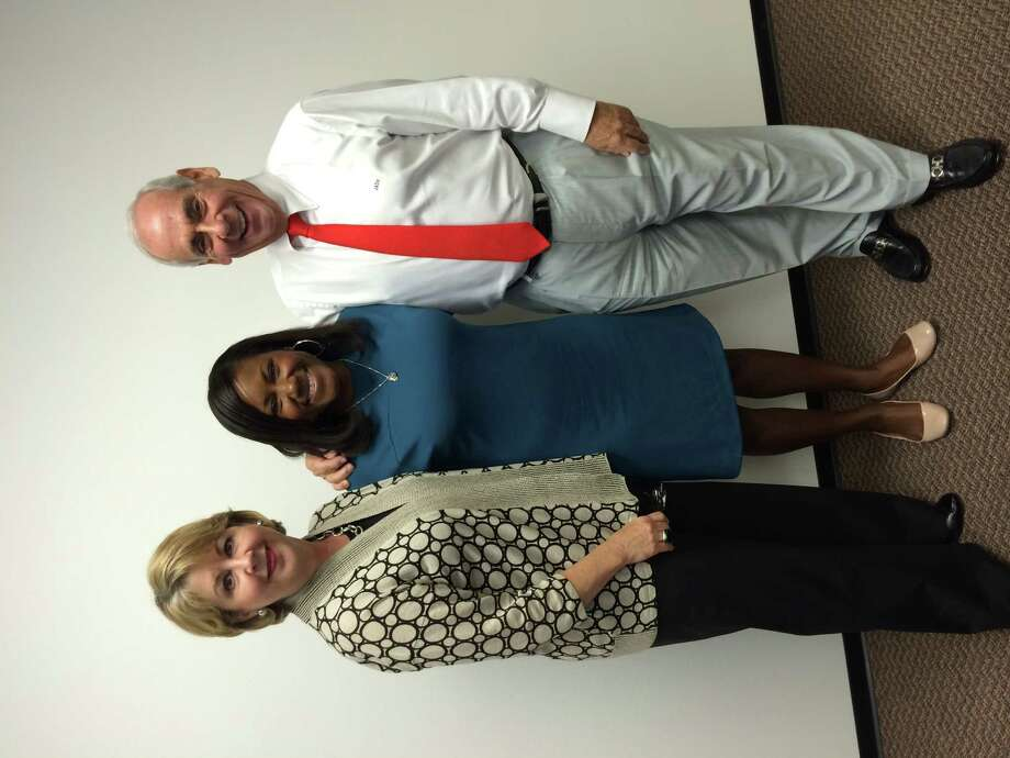 John Daugherty, Realtors' Global Relocation Department welcomed Aisha Crumbine of Crumbine Education Consulting LLC, as a guest speaker to its weekly sales meeting Tuesday, June 24. Crumbine's message focused on how sales associates can best assist clients, relocating from other areas, to familiarize themselves with the educational landscape in Houston, as this particular process can be one of the most stressful aspects of relocating. Crumbine highlighted three significant points to focus on when narrowing down a school search:  Start early;   Focus on the thing that matters the most — the child; and Commit to the process. Crumbine Educational Consulting LLC has more than 15 years of experience in education and extensive relationships with independent, public and charter schools. Shown left to right are Chaille Ralph, 2014 chair of Houston Association of Realtors; Aisha Crumbine and John Daugherty, owner of John Daugherty, Realtors.