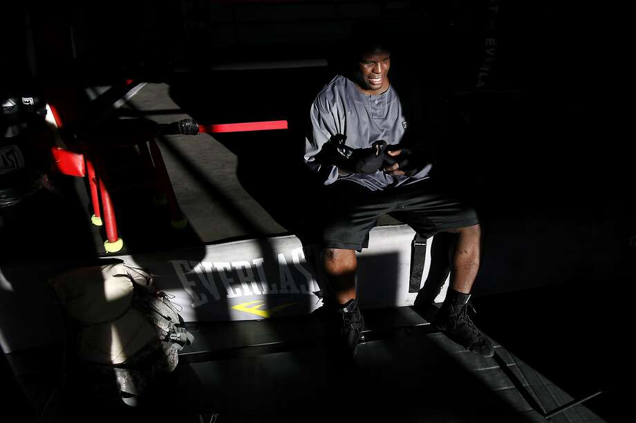 San Francisco 49ers running back Frank Gore takes off his gloves after sparring with Brian Schwartz, his trainer and the owner of Undisputed Boxing Gym in San Carlos, Calif., on Saturday, June 28, 2014. Photo: Sarah Rice, Special To The Chronicle