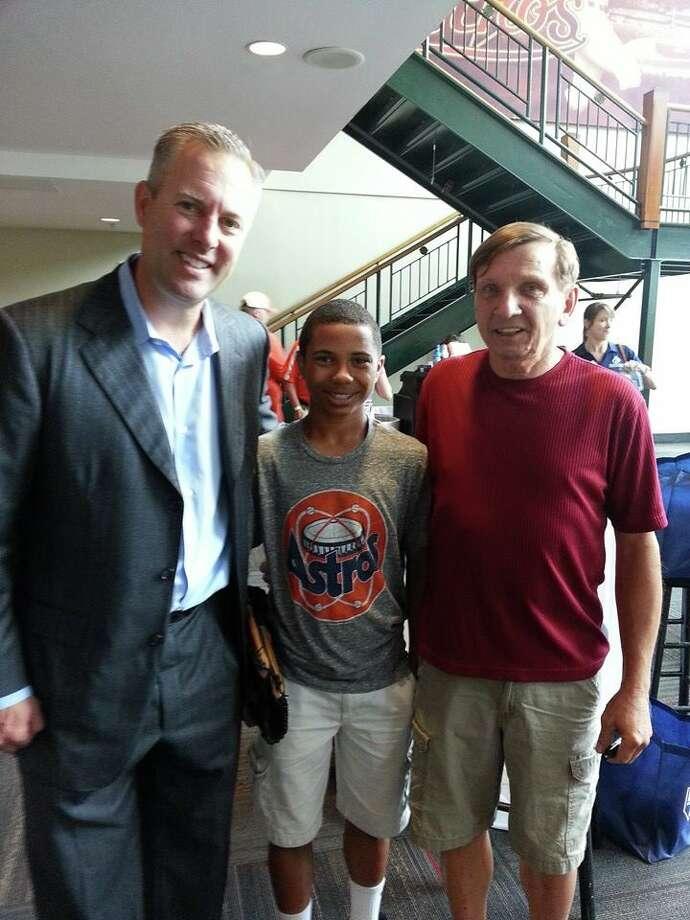 Reid Ryan visits with Dre Bruman and Dave Bruman.