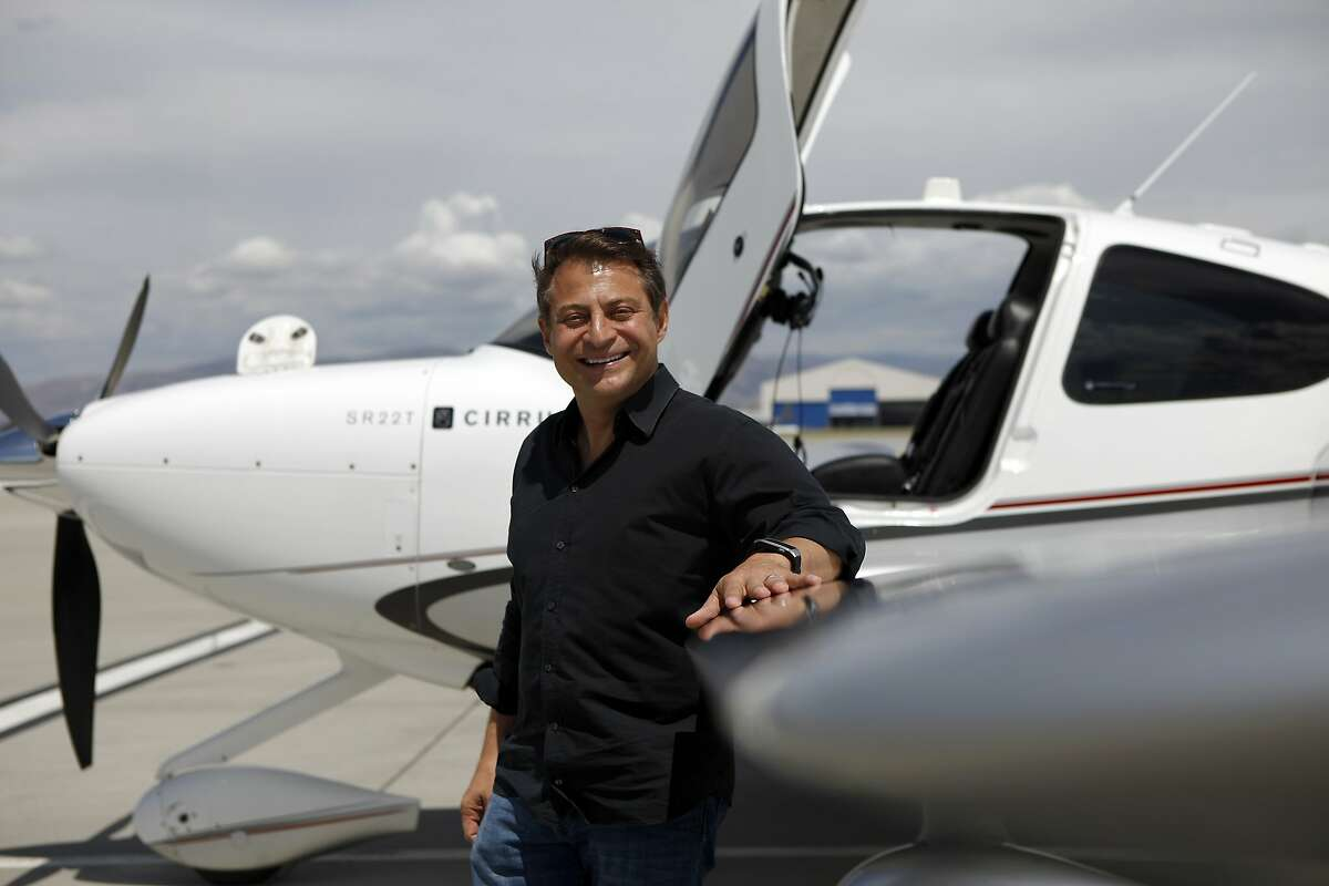 Peter Diamandis stands next to his Cirrus SR22T airplane at Moffett Field in Mountain View, CA, Friday May 20, 2014, before flying himself and colleagues down to Los Angeles.