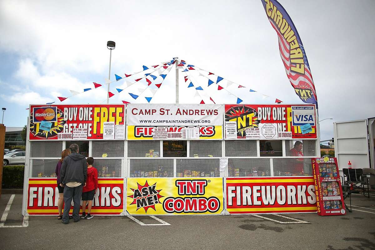 SAN BRUNO, CA - JULY 03: Customers shop for fireworks at the Camp St. Andrews fireworks stand on July 3, 2014 in San Bruno, California. As California's historic drought continues and fire danger is at severe levels, fire departments in the greater San Francisco Bay Area are on heightened alert as vendors in select cities in Santa Clara, San Mateo and Alameda counties sell fireworks ahead of the Fourth of July holiday. (Photo by Justin Sullivan/Getty Images)