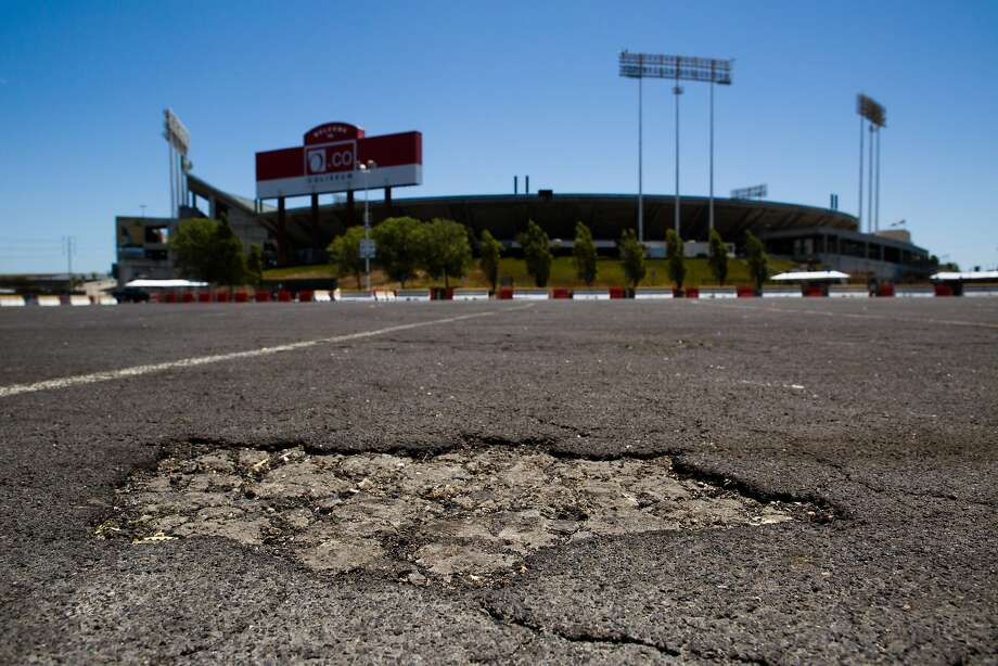 The parking lot outside the O.co Coliseum shows degradation in Oakland, Calif. on Thursday, July 3, 2014. Photo: Tim Hussin, Special To The Chronicle