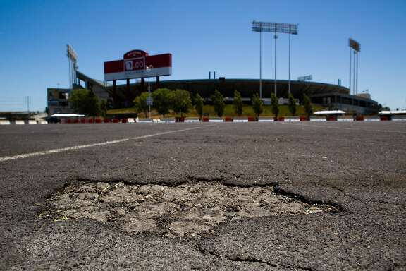 The parking lot outside the O.co Coliseum shows degradation in Oakland, Calif. on Thursday, July 3, 2014.