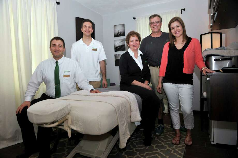 The Conner Family, owner'sm of Healthy Weighs Wellness Center, 356 Federal Road, Brookfield, Conn. Thursday, July 3, 2014. Thye are from left, Dr. Brian Conner, chiropractor, Billy Conner, office manager, Dr. Julie Conner, nutricionist, William Conner, COO and Kristi Conner, 22, marketing director. Photo: Carol Kaliff / The News-Times