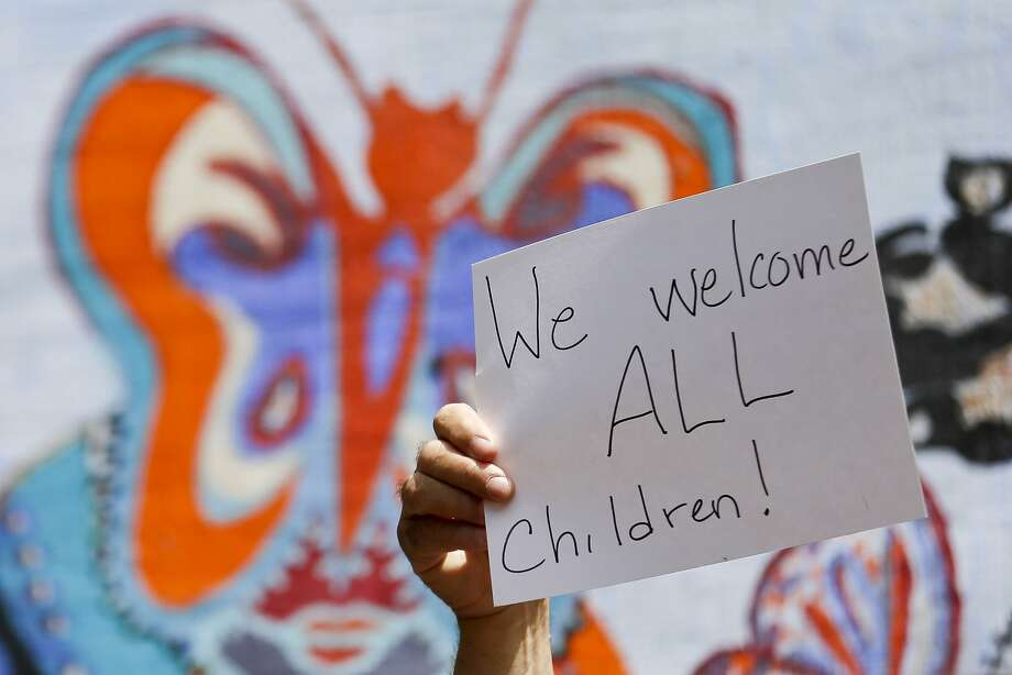 A supporter of refugee children joins a rally in San Diego on Wednesday. Photo: Gregory Bull, Associated Press