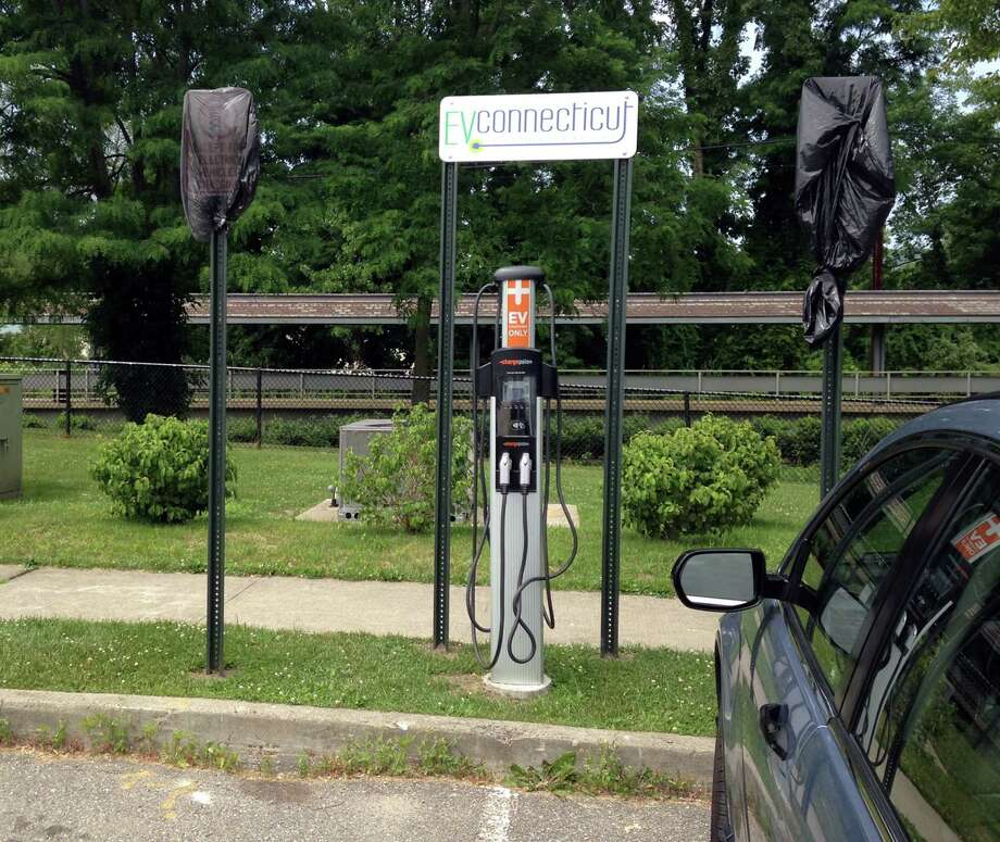 An electric vehicle charging station installed as part of the stateâÄôs EVConnecticut program is now active at the Metro-North station on Durant Avenue in Bethel. Photo: Denis O'Malley, Denis O'malley / The News-Times