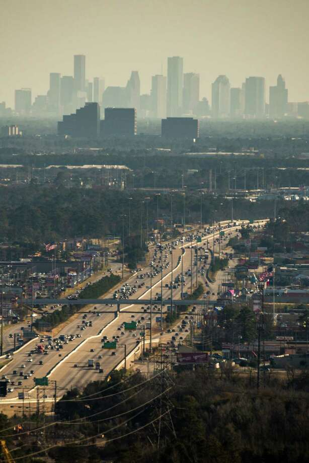 The downtown skyline looms over traffic on I-45 south of The Woodlands on Monday, Jan. 20, 2014, in Houston. ( Smiley N. Pool / Houston Chronicle ) Photo: Smiley N. Pool, Staff / Â 2013  Houston Chronicle