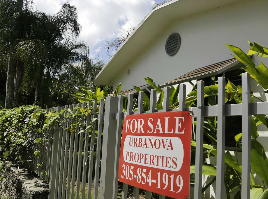 Sales of homes like this duplex in Miami are expected to pick up now that mortgage rates have dipped below where they were last year at this time. Photo: Lynne Sladky, Associated Press
