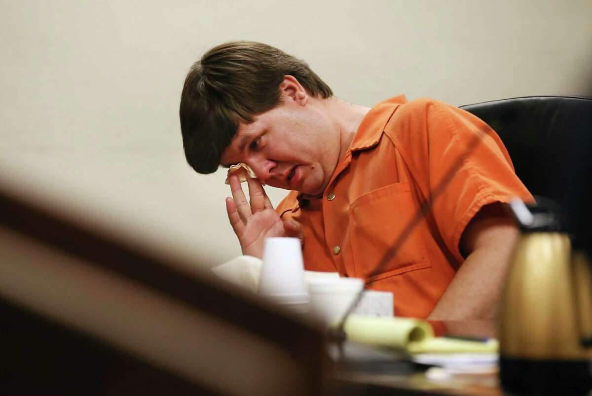 Texas ranked 11th in hyperthermia deaths of children in vehicles from 1998 to 2012, the study showed, with 86 deaths per 1 milllion people 14 years old or younger. Pictured, Justin Ross Harris, the father of a toddler who died after police say he was left in a hot car for about seven hours, wipes his eye as he sits during his bond hearing in Cobb County Magistrate Court, Thursday, July 3, 2014, in Marietta, Ga.